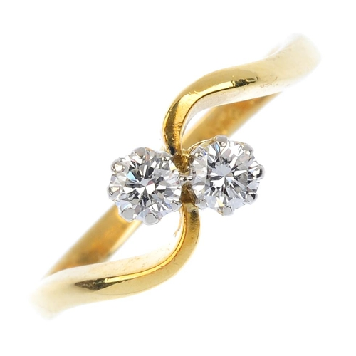 78 - An 18ct gold diamond crossover ring. The brilliant-cut diamond diagonal line, with asymmetric should...