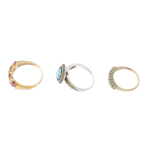 780 - Three 9ct gold diamond and gem-set rings. To include a ruby and diamond panel ring, a blue topaz and...