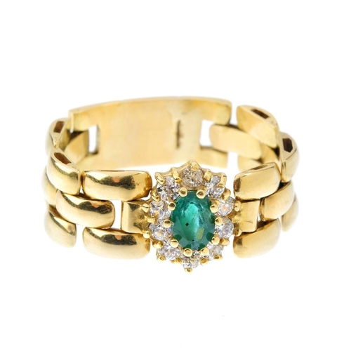 783 - An emerald and paste articulated ring. The oval-shape emerald, with colourless paste surround and br...