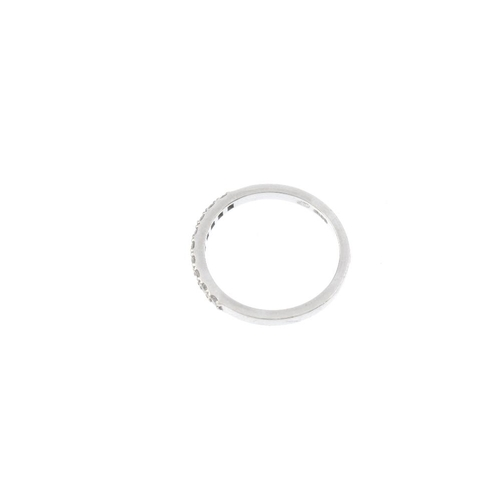 785 - A platinum diamond half-circle eternity ring. Designed as a brilliant-cut diamond line, to the plain...