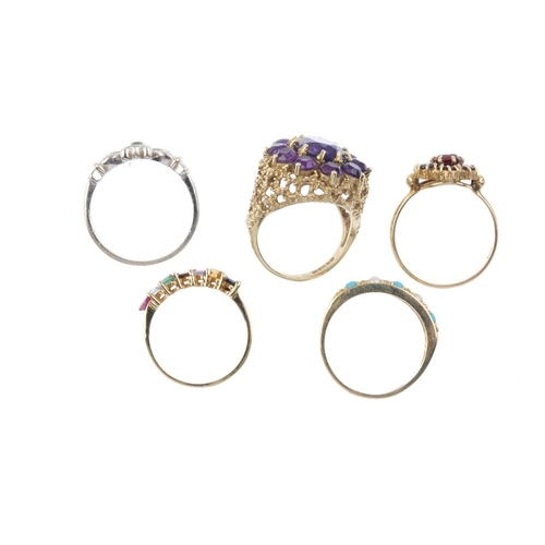 787 - Five gem-set rings. To include a 14ct gold multi-gem line ring, a 9ct gold amethyst cluster ring, a ...