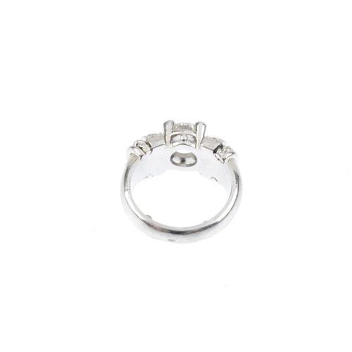 794 - A diamond single-stone ring. The brilliant-cut diamond, with single-cut diamond line sides and rope-...