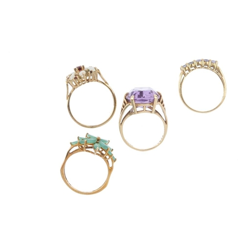 796 - Four 9ct gold gem-set dress rings. To include an opal and garnet cluster ring, an amethyst single-st...