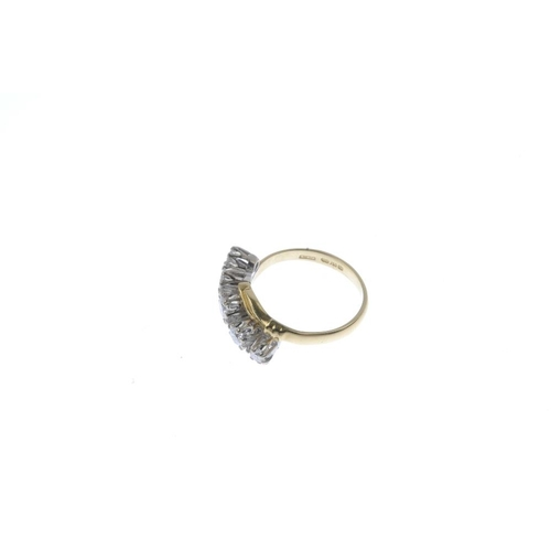 797 - An 18ct gold diamond five-stone ring. The graduated brilliant-cut diamond line, with crossover shoul...