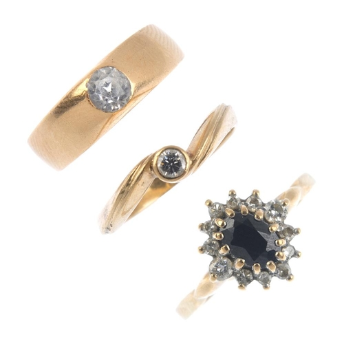 799 - Three diamond and gem-set rings. To include a 9ct gold sapphire and diamond cluster ring, a 9ct gold...