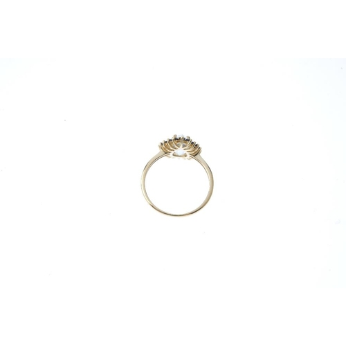 80 - A gem-set ring and pendant. The ring designed as a 9ct gold pear-shape aquamarine within a circular-...