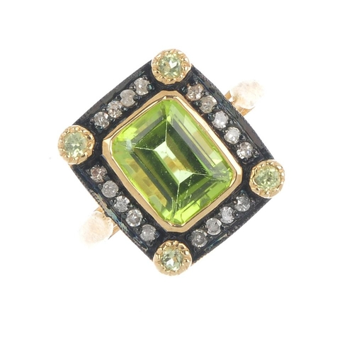 800 - A 9ct gold peridot and diamond dress ring. The rectangular peridot, within a peridot accent and sing...