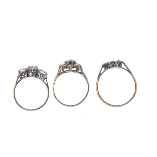 801 - Three gold gem-set rings. To include a mid 20th century 18ct gold illusion-set single-cut diamond th...