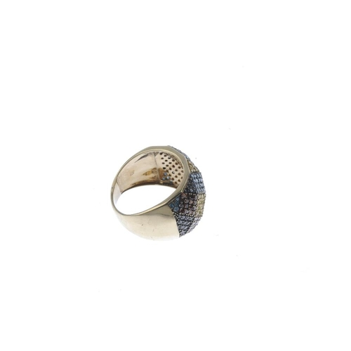 803 - A 9ct gold colour treated diamond dress ring. Designed as a pave-set colour treated 'vari-colour' di...