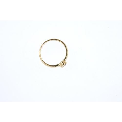 804 - An 18ct gold diamond single-stone ring. The brilliant-cut diamond collet, with plain band. Diamond w...