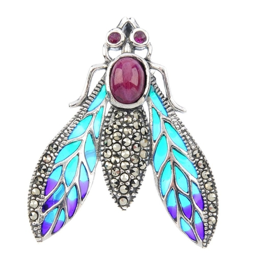 805 - A ruby, marcasite and plique-a-jour enamel fly brooch. The oval ruby cabochon and marcasite body, wi...