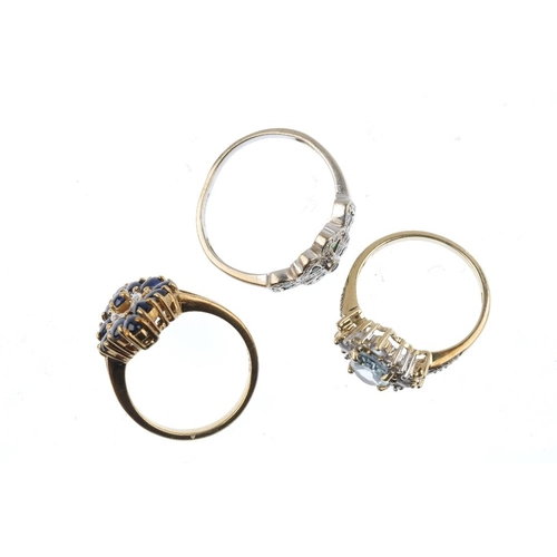 806 - Three 9ct gold gem-set rings. To include an emerald and diamond dress ring, a sapphire and diamond c...