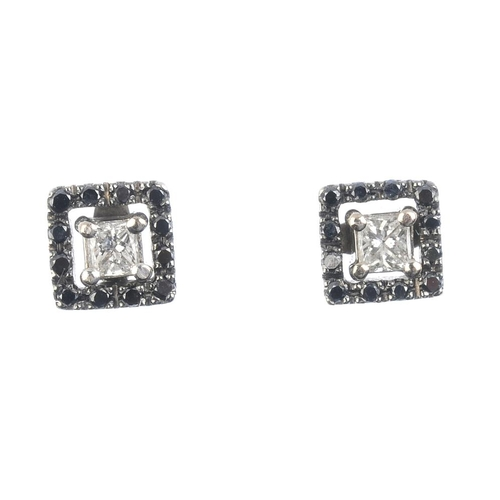 807 - A pair of diamond and gem-set earrings. Each designed as a square-shape diamond, within a circular-s...