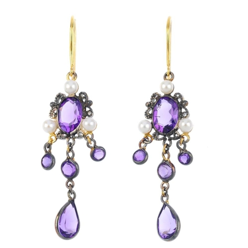 810 - A pair of amethyst and cultured pearl earrings. Each designed as an oval-shape amethyst collet, with...