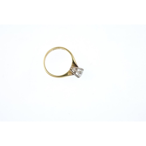 812 - An 18ct gold diamond single-stone ring. The brilliant-cut diamond, with tapered shoulders. Estimated...