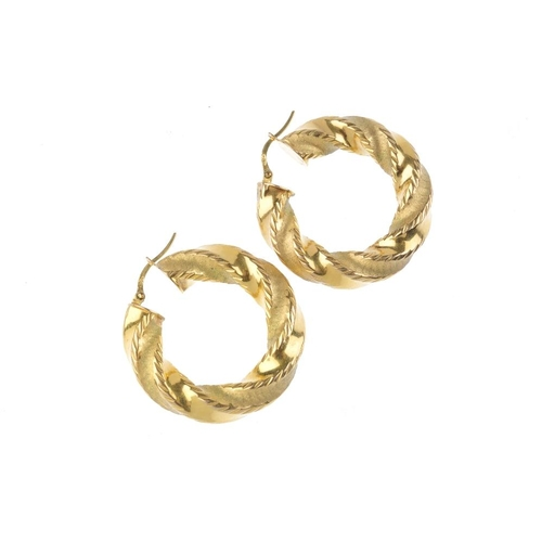 814 - Three pairs of earrings. To include a pair of polished ear hoops, a pair of spiral and textured ear ...