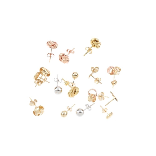 818 - Eleven pairs of stud earrings. To include a pair of horsehead stud earrings, a pair of knot stud ear...