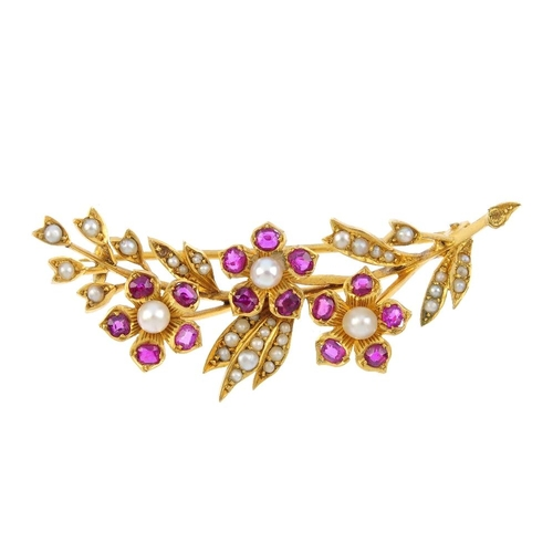 821 - A ruby, seed and split pearl floral brooch. Designed as three seed pearl and ruby flowers, with a sp...