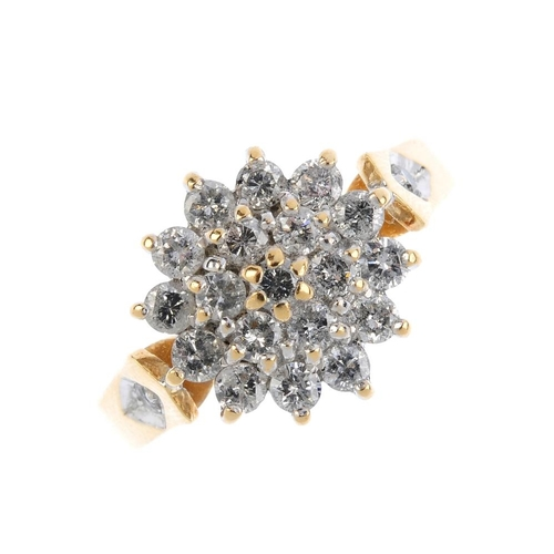 825 - An 18ct gold diamond cluster ring. Designed as a brilliant-cut diamond stepped cluster, with similar...