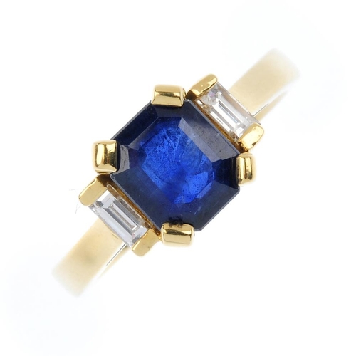 826 - An 18ct gold sapphire and diamond ring. The rectangular-shape sapphire, with baguette-cut diamond si...