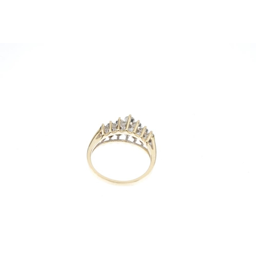 828 - A diamond dress ring. The graduated brilliant-cut diamond lines, with openwork sides. Estimated tota...