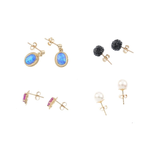 830 - Ten pairs of gem-set earrings. To include a pair of cultured pearl stud earrings, a pair of sapphire...