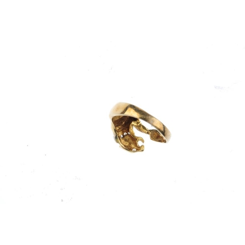831 - A cubic zirconia novelty ring. Designed as a pouncing panther catching its tail, with circular-shape...