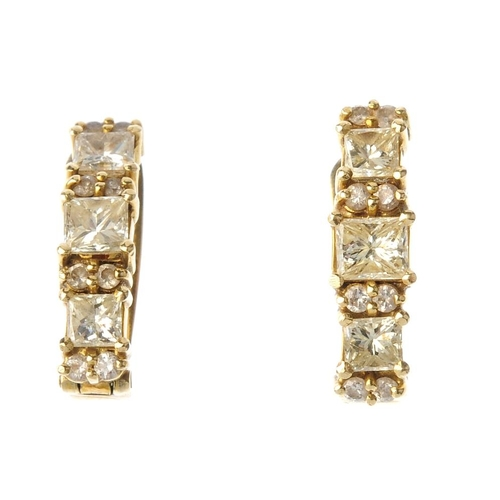 833 - A pair of diamond earrings. Each designed as a square-shape diamond line, with brilliant-cut diamond...