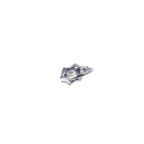 835 - An onyx and diamond dress ring. The brilliant-cut diamond collet, within a calibre-cut onyx and sing...