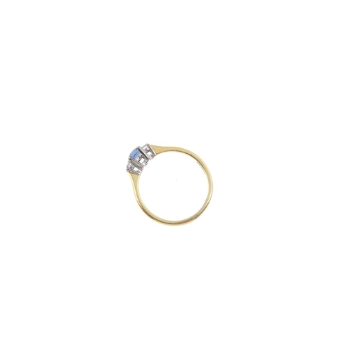837 - An 18ct gold sapphire and diamond three-stone ring. The rectangular-shape sapphire, with brilliant-c...