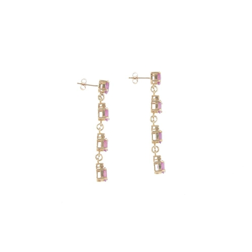839 - A 9ct gold glass-filled ruby bracelet and matching earrings. The bracelet designed as a series of ov...