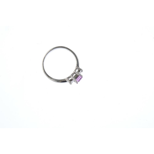 84 - An 18ct gold sapphire and diamond dress ring. The square-shape pink sapphire, with square-shape diam...