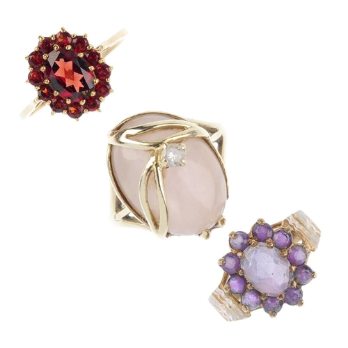 840 - Four gold gem-set rings. To include an 18ct gold peridot single-stone ring. a 9ct gold amethyst clus...