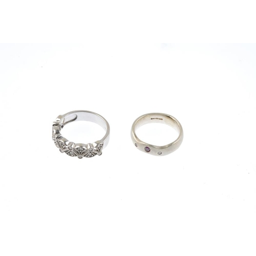 841 - Two 9ct gold diamond dress rings. To include an diamond openwork dress ring, together with a purple ...