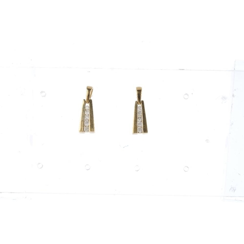 844 - Two pair of 9ct gold diamond and gem-set earrings. The first pair each designed as a graduated brill...