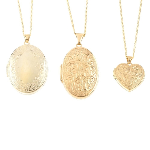 852 - Three lockets. To include a 9ct gold oval-shape locket, with scroll engraving, suspended from a 9ct ...
