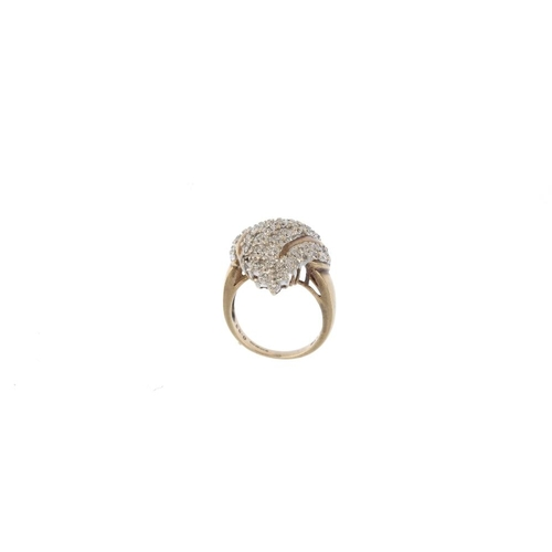 856 - A 9ct gold diamond cluster ring. Of marquise-shape outline, the undulating pave-set diamond cluster,...