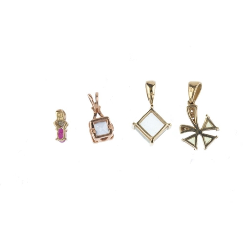 857 - Six gem-set pendants. To include a 9ct gold ruby and diamond foliate cluster pendant suspended from ...