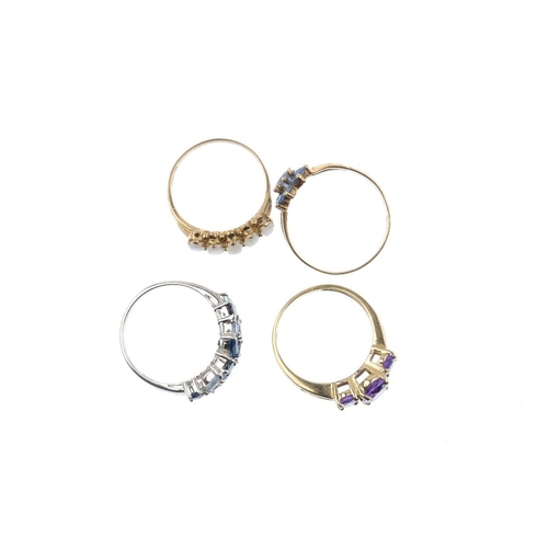 859 - Four 9ct gold gem-set dress rings. To include an oval opal cabochon five-stone ring, an oval-shape a...