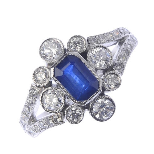86 - A sapphire and diamond dress ring. The rectangular-shape sapphire, with vari-size brilliant-cut diam...