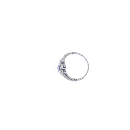 86 - A sapphire and diamond dress ring. The rectangular-shape sapphire, with vari-size brilliant-cut diam...