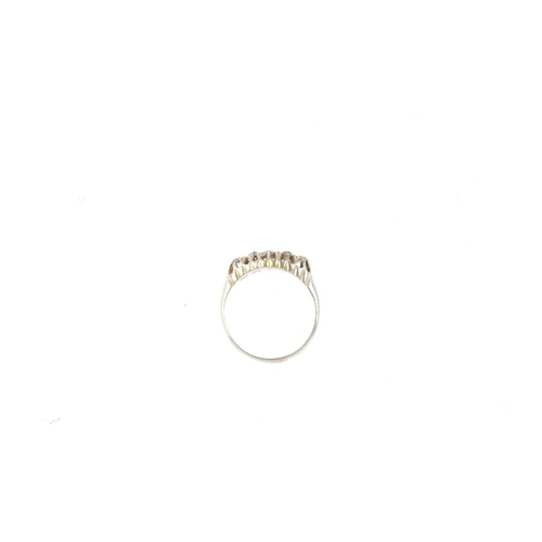 863 - An early 20th century 18ct gold diamond five-stone ring. The slightly graduated old-cut diamond line...