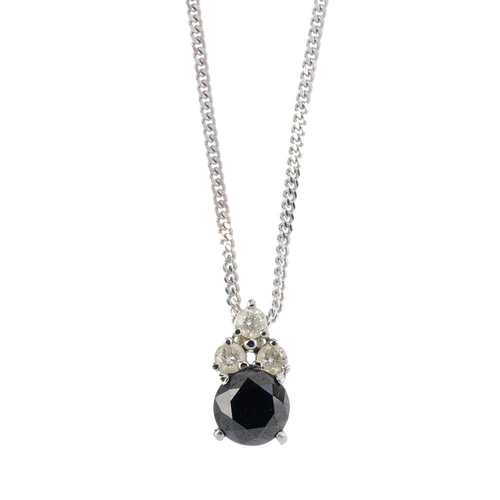 866 - A black-gem and diamond pendant, with black-gem stud earrings. To include a pendant designed as a ci...