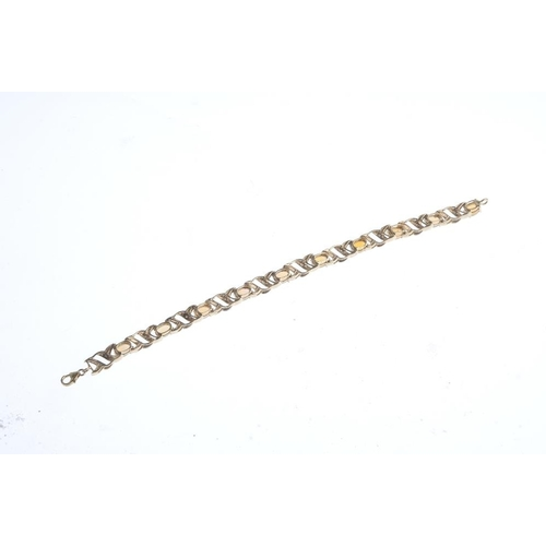 867 - A 9ct gold opal and diamond bracelet. Designed as a series of ten oval opal cabochons, with single-c...