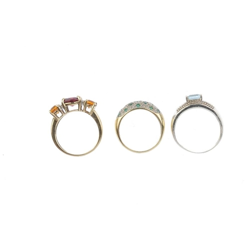 870 - Three 9ct gold diamond and gem-set rings. To include an emerald and diamond dress ring, a garnet, ci...