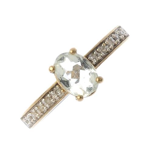 871 - Three 9ct gold gem-set dress rings. To include an aquamarine and diamond three-stone ring, a prasiol...