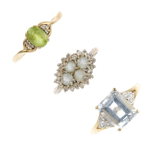 876 - Three 9ct gold diamond and gem-set rings. To include a blue topaz quatrefoil and brilliant-cut diamo...