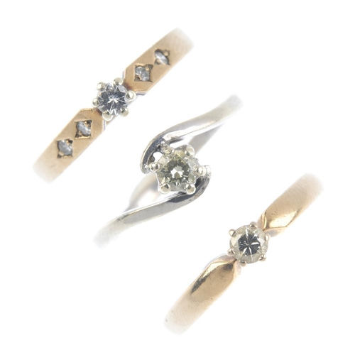877 - Three 9ct gold diamond single-stone rings. Each set with a brilliant-cut diamond, with asymmetric, d...