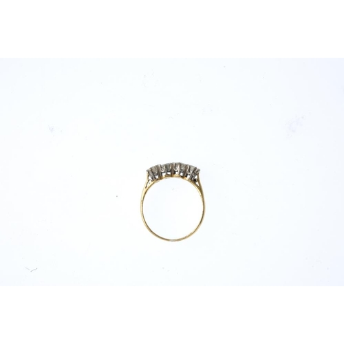 878 - A diamond four-stone ring. Comprising a brilliant-cut diamond line, with tapered shoulders and plain...