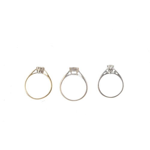 879 - Three 9ct gold diamond dress rings. To include two diamond single-stone rings with tapered shoulders...